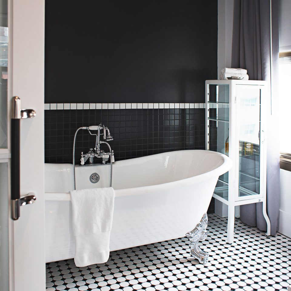Bath City Modern bathroom property bathtub vessel plumbing fixture white bidet flooring Suite public toilet toilet tub tiled tile