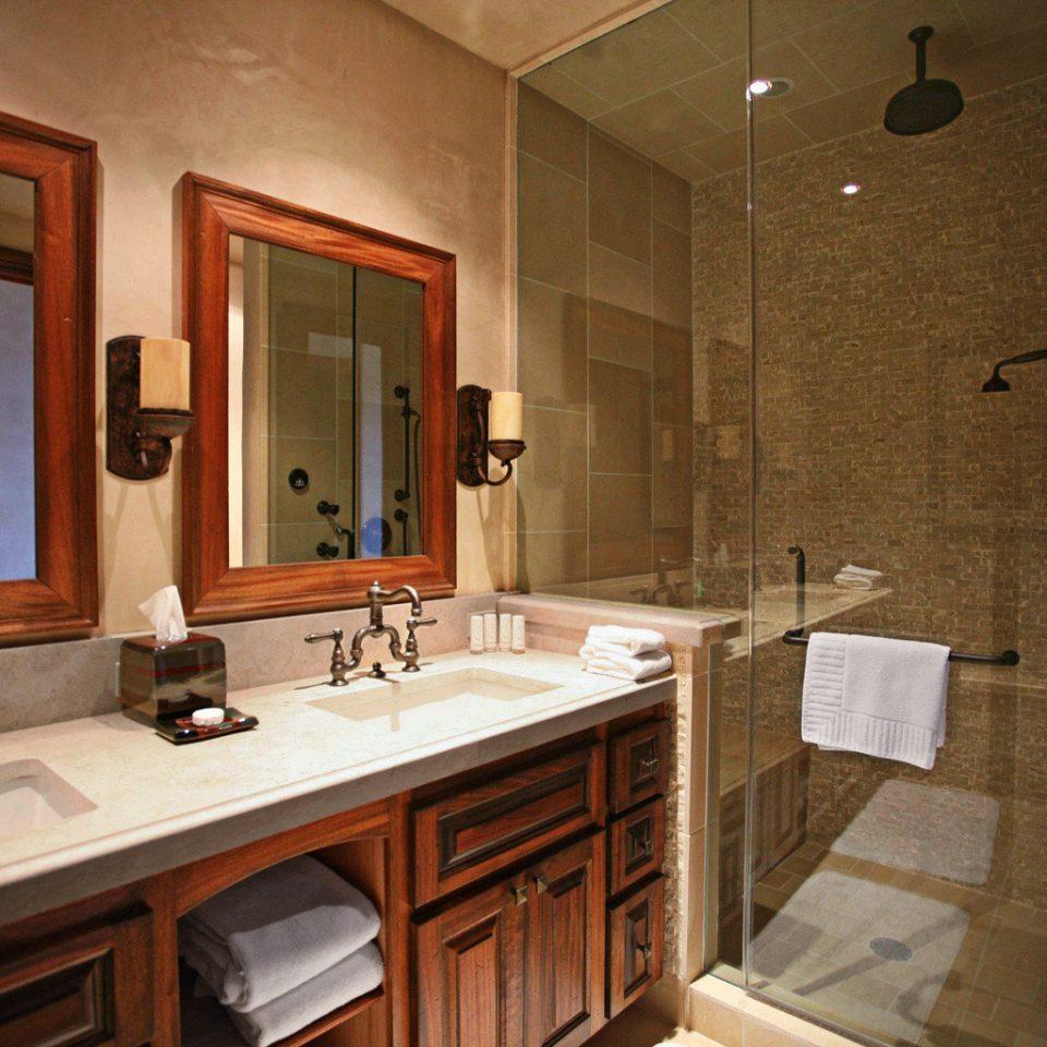 Bath Classic Resort bathroom mirror sink property home cabinetry Suite Kitchen cottage countertop clean tile tub bathtub