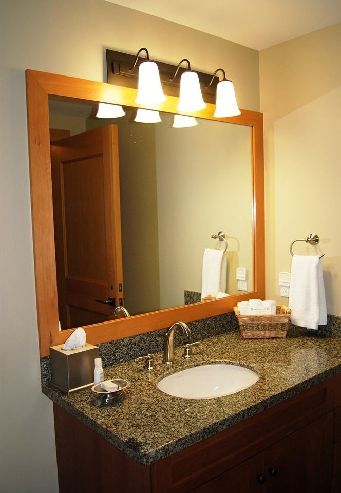 Bath Classic Lodge bathroom mirror sink vanity counter property home lighting cabinetry Suite tan