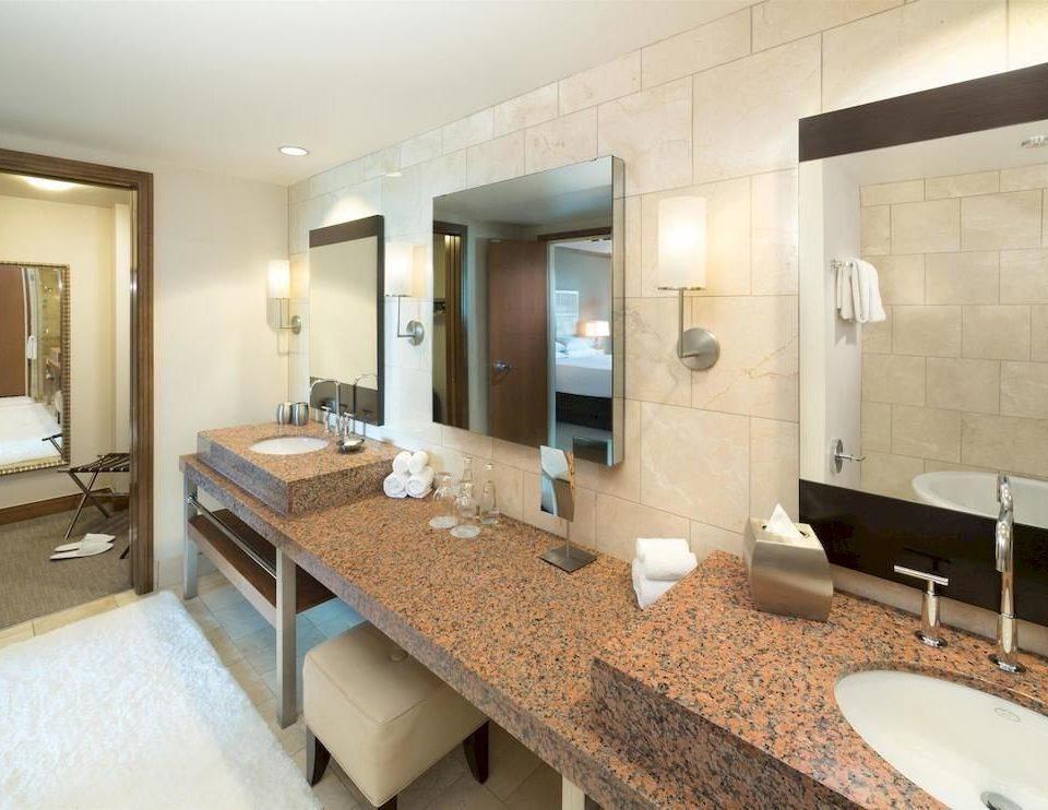 Bath Classic Resort bathroom sink mirror property condominium Suite counter home Villa flooring Modern tan