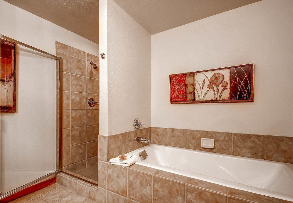 Bath Classic Resort bathroom property mirror sink vessel home flooring plumbing fixture bathtub tile tiled tan