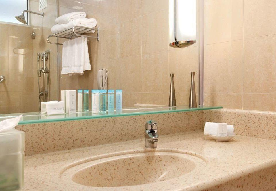 Bath Classic Resort bathroom sink property toilet flooring counter plumbing fixture home tile countertop Suite swimming pool material bathtub