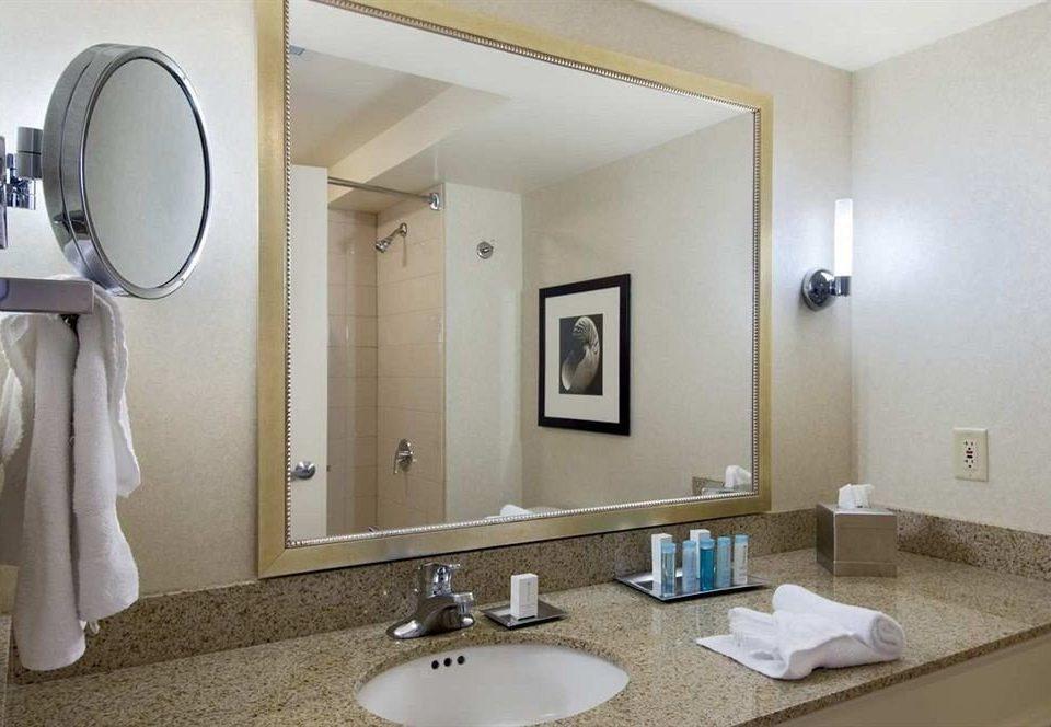 Bath Classic Resort bathroom sink mirror property towel Suite vanity home plumbing fixture double bidet rack tan clean