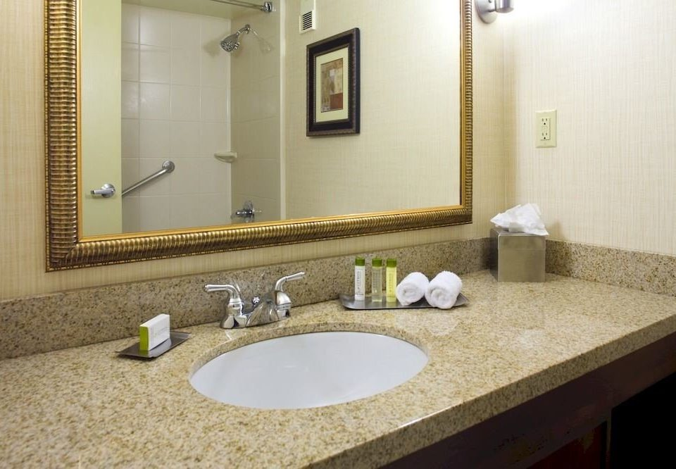 Bath Classic Resort bathroom mirror sink property countertop flooring Suite counter home plumbing fixture swimming pool towel clean tan