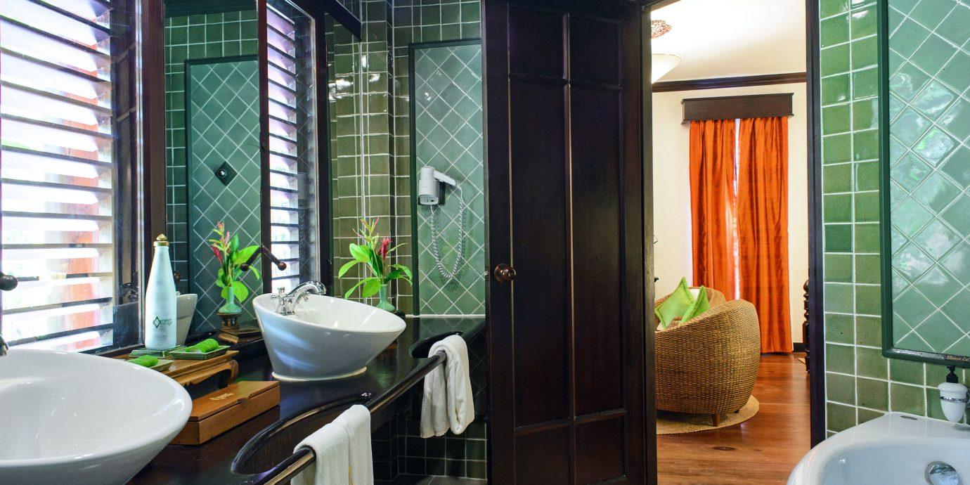 Bath Classic Romance Romantic Wellness bathroom sink property green Suite home condominium swimming pool tub tiled bathtub