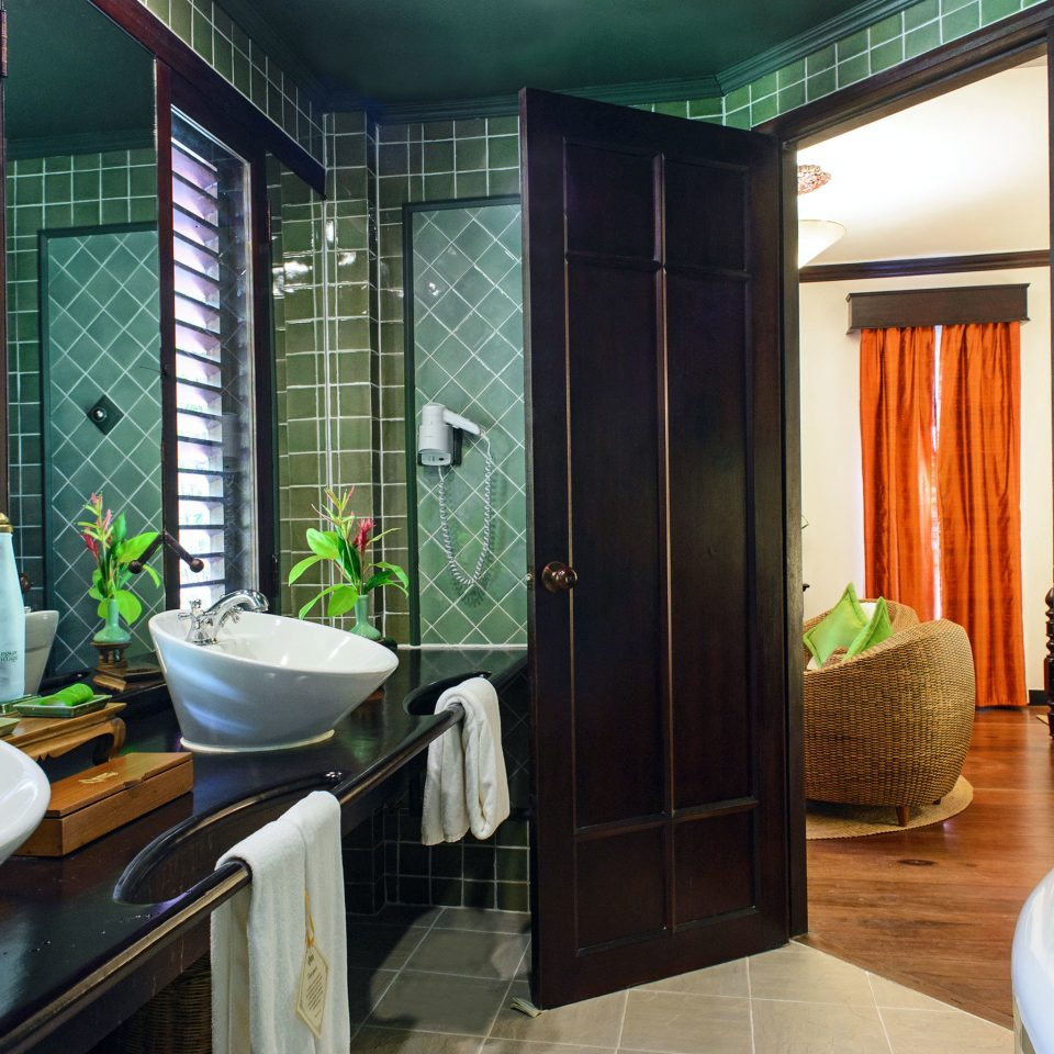 Bath Classic Romance Romantic Wellness bathroom sink property green Suite home condominium swimming pool tub tiled bathtub