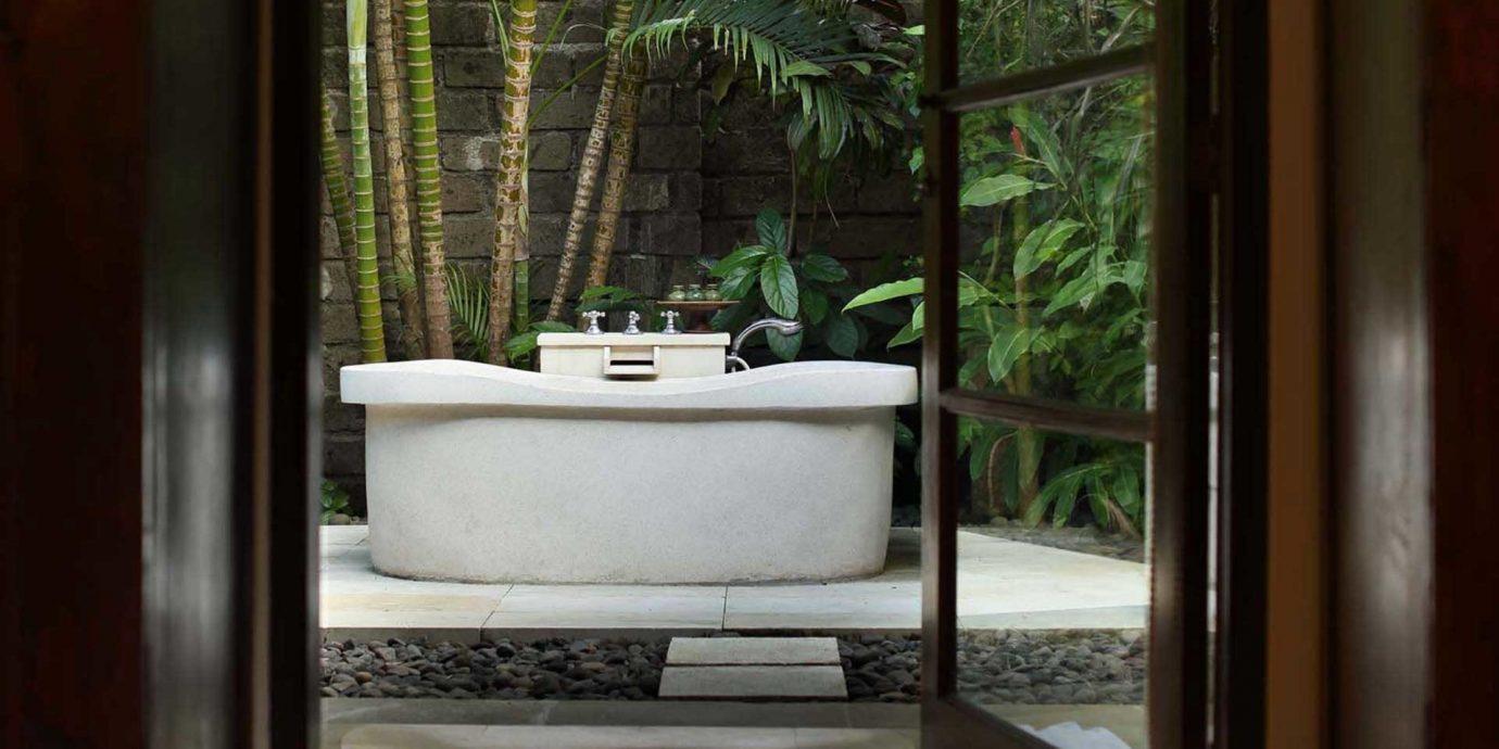 Bath Cultural Eco Elegant Jungle Outdoors Patio Resort house home bathroom swimming pool plumbing fixture plant