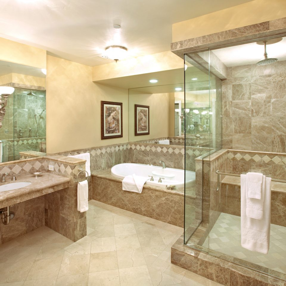 Bath Elegant Historic Inn Romantic bathroom property sink home flooring mansion plumbing fixture tub stone bathtub tile tiled tan