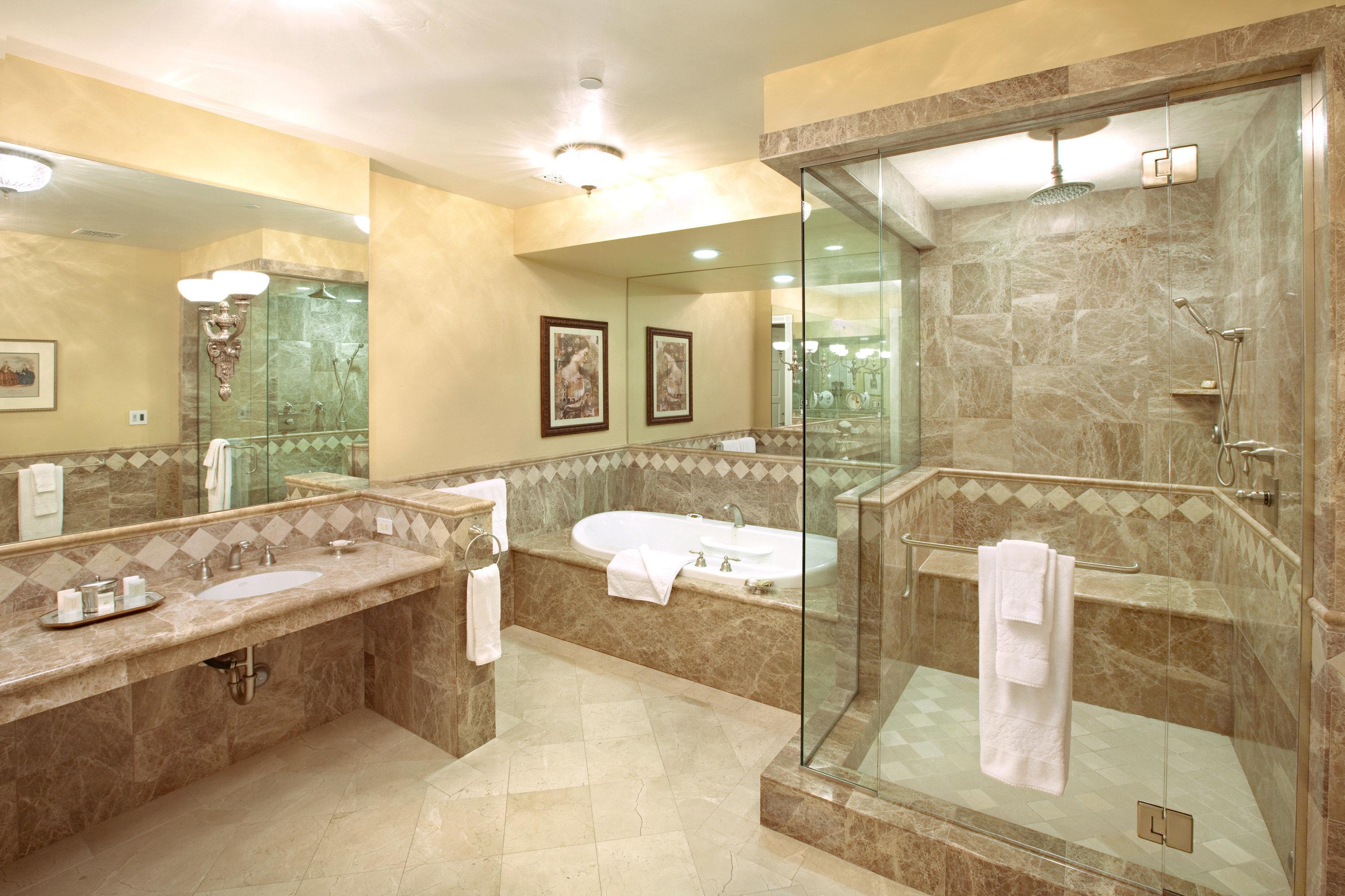 Bath Elegant Historic Inn Romantic bathroom property sink home flooring mansion plumbing fixture tub stone bathtub tile tiled tan