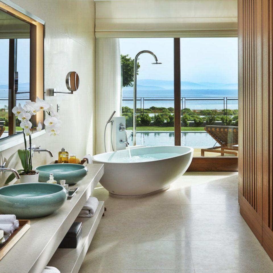 Bath Elegant Hotels Luxury Scenic views bathroom property swimming pool home Suite bathtub tub green