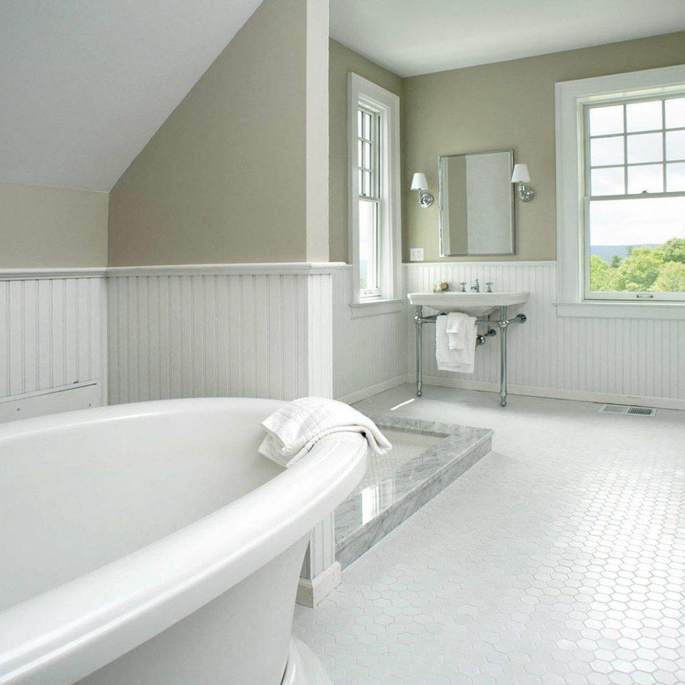 Bath Elegant Inn Modern Romantic bathroom property sink bathtub white green home flooring vessel bidet tub