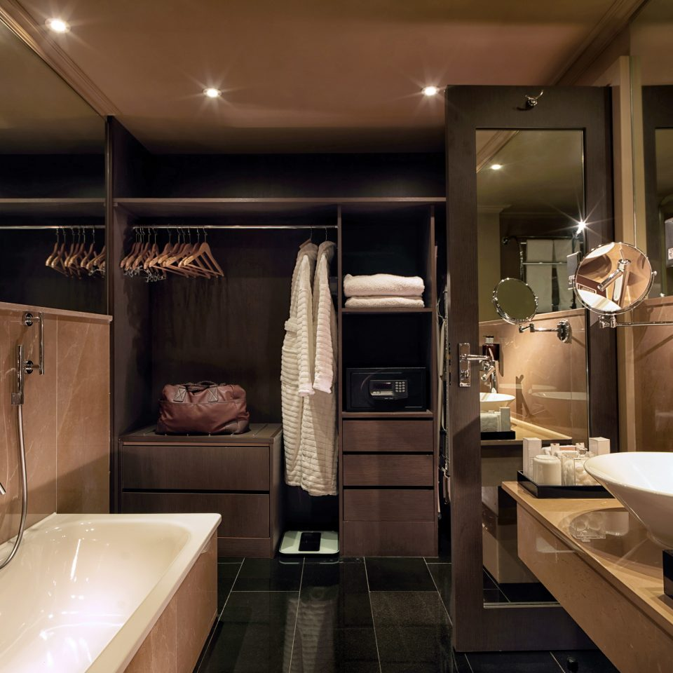 Bath Elegant Modern bathroom sink mirror property home toilet lighting vehicle living room cabinetry Suite yacht tub bathtub
