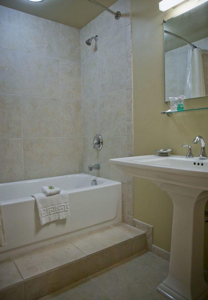 Bath Family bathroom sink property home tub plumbing fixture vessel tile bathtub tiled tan