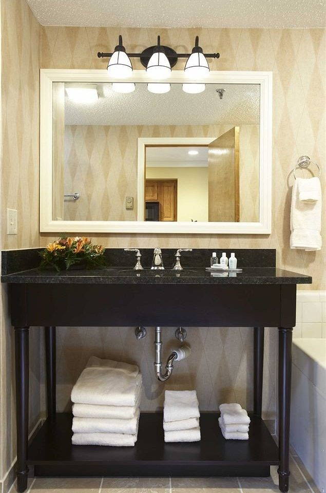 bathroom mirror sink cabinetry towel Fireplace living room vanity home Bath