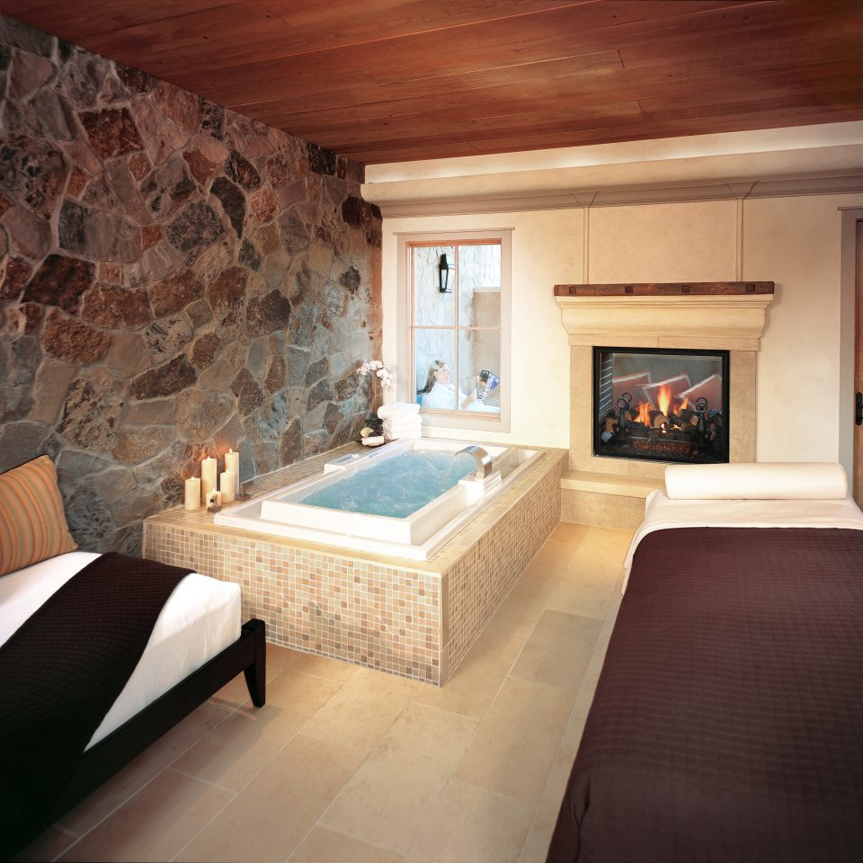 Bath Hotels Luxury Romance Spa Spa Retreats Trip Ideas sofa property house Fireplace living room home hardwood cottage Suite stone wood flooring mansion