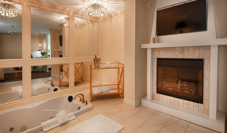 bathroom property home sink house living room cabinetry hardwood Fireplace cottage flooring mansion Kitchen tub Bath tile bathtub