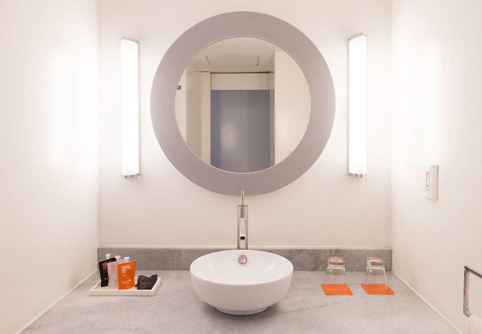 Bath Hip bathroom toilet property bidet sink plumbing fixture flooring tile tiled