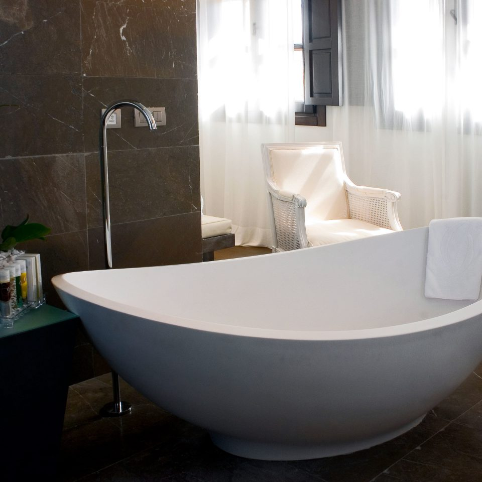 Bath Hip Modern bathtub bathroom property plumbing fixture bidet swimming pool tub flooring tiled
