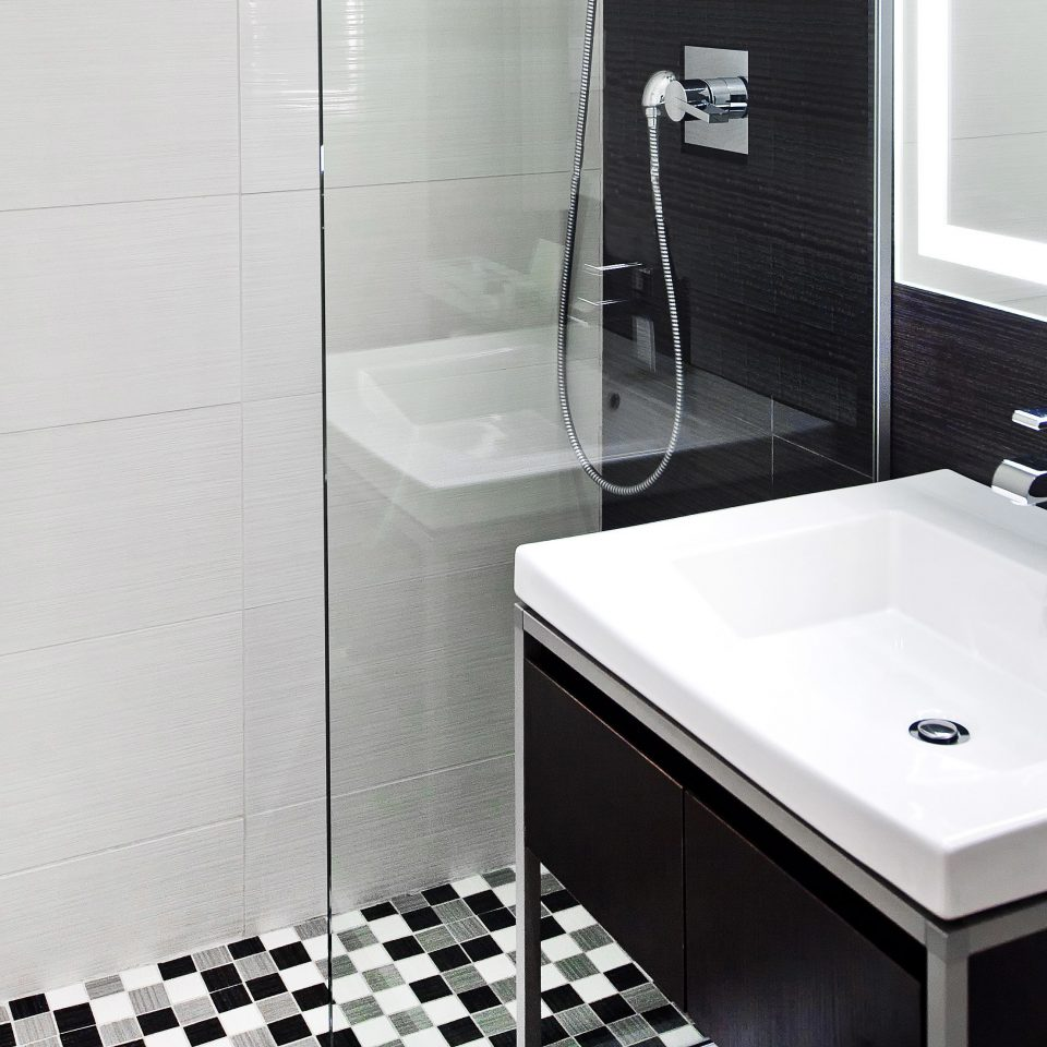Bath Hip Modern bathroom plumbing fixture white bathtub bidet sink flooring toilet tile