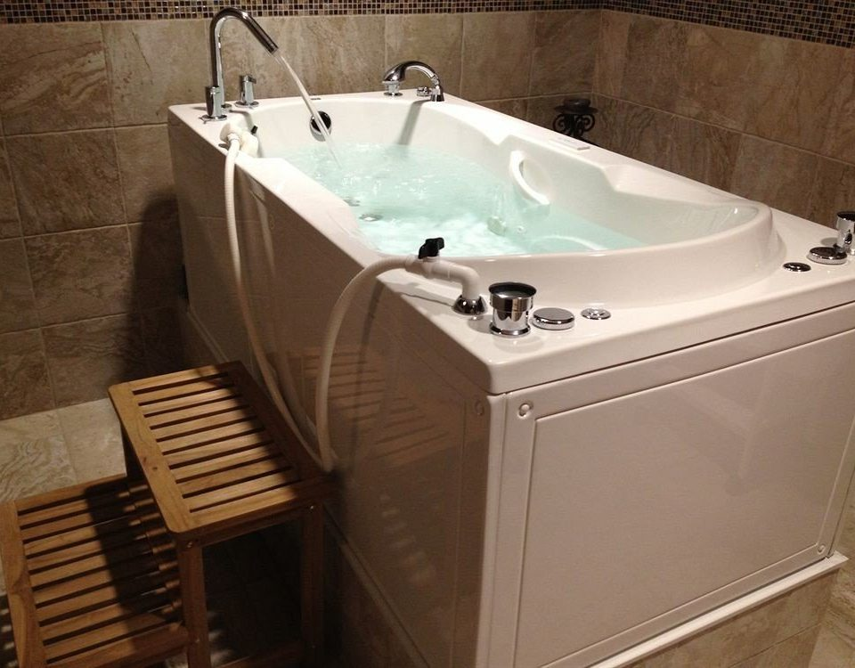 vessel bathroom swimming pool bathtub jacuzzi plumbing fixture sink Hot tub bidet tub Bath tiled tan tile water basin