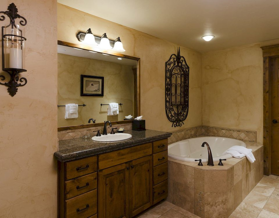 Bath Hot tub Hot tub/Jacuzzi Resort bathroom property home cabinetry sink cottage flooring tub