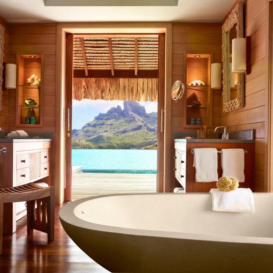 Bath Hotels Luxury Trip Ideas property bathroom home hardwood Suite condominium swimming pool bathtub Island