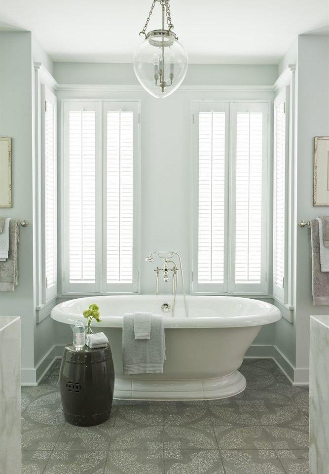 Bath Inn bathroom plumbing fixture flooring bathroom cabinet tub