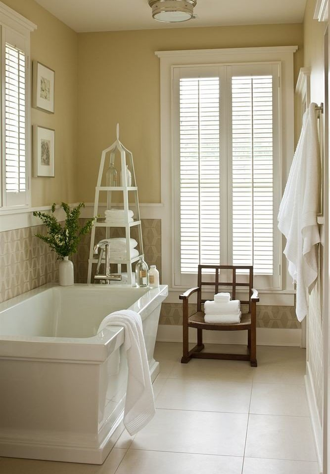 Bath Inn white living room home tub flooring curtain bathroom textile bathtub window treatment hall tile