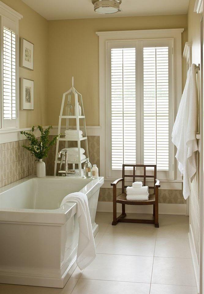 Bath Inn white living room home tub flooring curtain bathroom textile bathtub window treatment hall tile