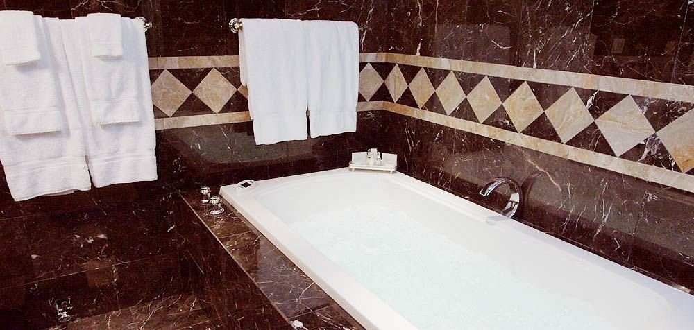Bath Inn bathroom property swimming pool house bathtub white flooring plumbing fixture jacuzzi tile tub tiled