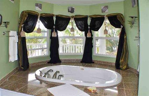 Bath Inn Romantic bathroom property sink curtain vessel textile window treatment bathtub