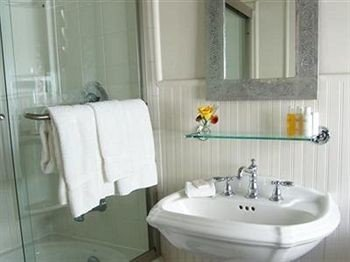 Inn Romantic bathroom toilet sink bathtub white bidet plumbing fixture towel tub Bath tile tiled water basin