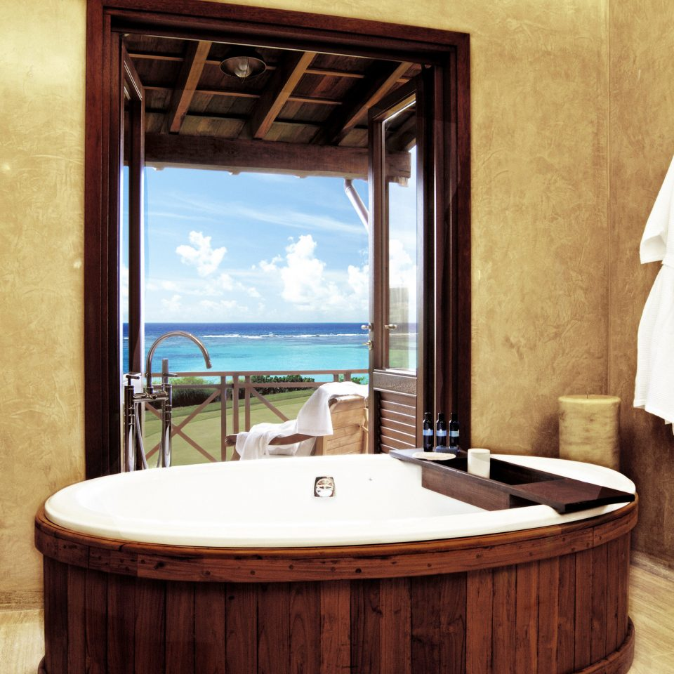 Bath Island Resort Scenic views Tropical bathroom property swimming pool Suite home jacuzzi sink cottage tub bathtub stone tile