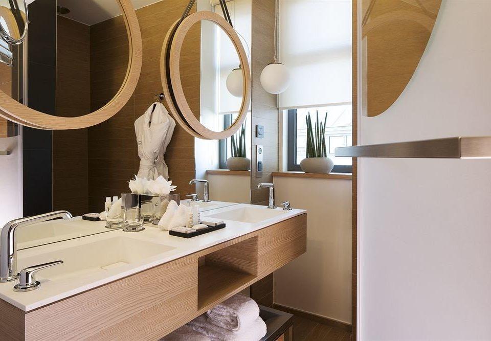 bathroom mirror sink countertop home Kitchen cabinetry bathroom cabinet flooring bathtub Bath