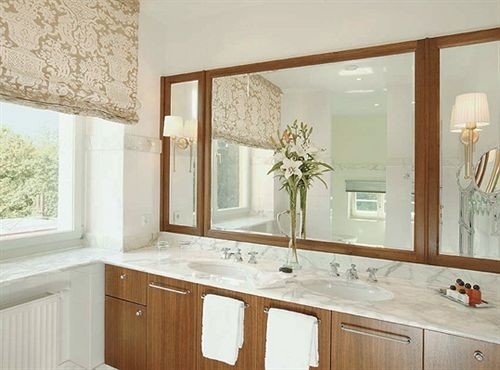 bathroom property countertop sink cabinetry home cuisine classique hardwood cottage Kitchen flooring Bath tub bathtub