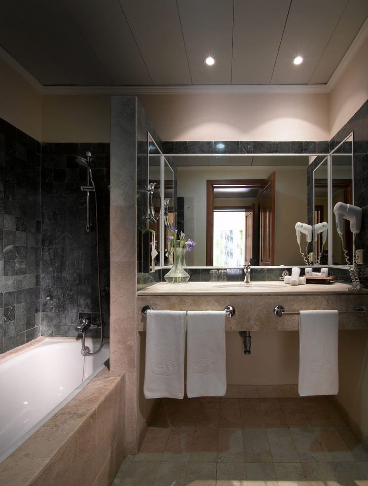 bathroom mirror property sink house home toilet Kitchen cabinetry tub tile Bath bathtub tiled