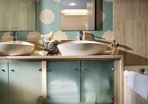 bathroom sink property countertop Kitchen bathtub plumbing fixture home toilet swimming pool tile flooring Bath
