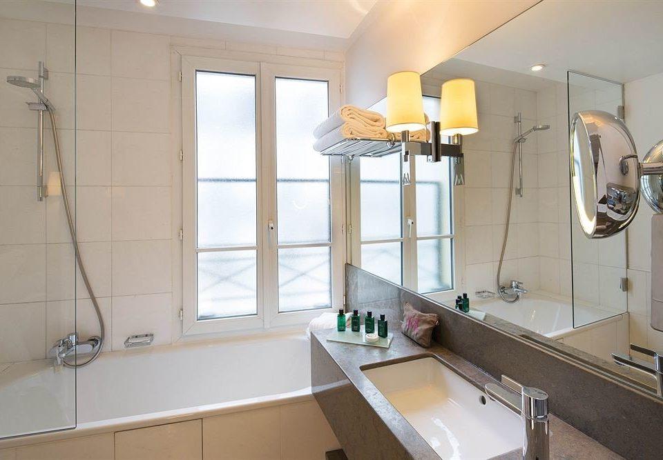 bathroom sink property home Kitchen cottage tub Bath bathtub tile kitchen appliance stove