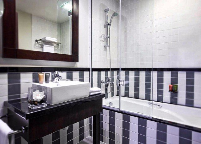 bathroom mirror sink property Kitchen condominium home tile flooring countertop tiled bathtub Bath kitchen appliance