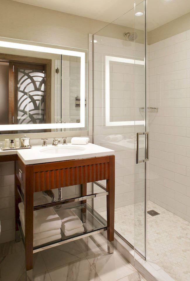 bathroom property cabinetry home sink Kitchen countertop plumbing fixture flooring tub tile Bath tiled bathtub