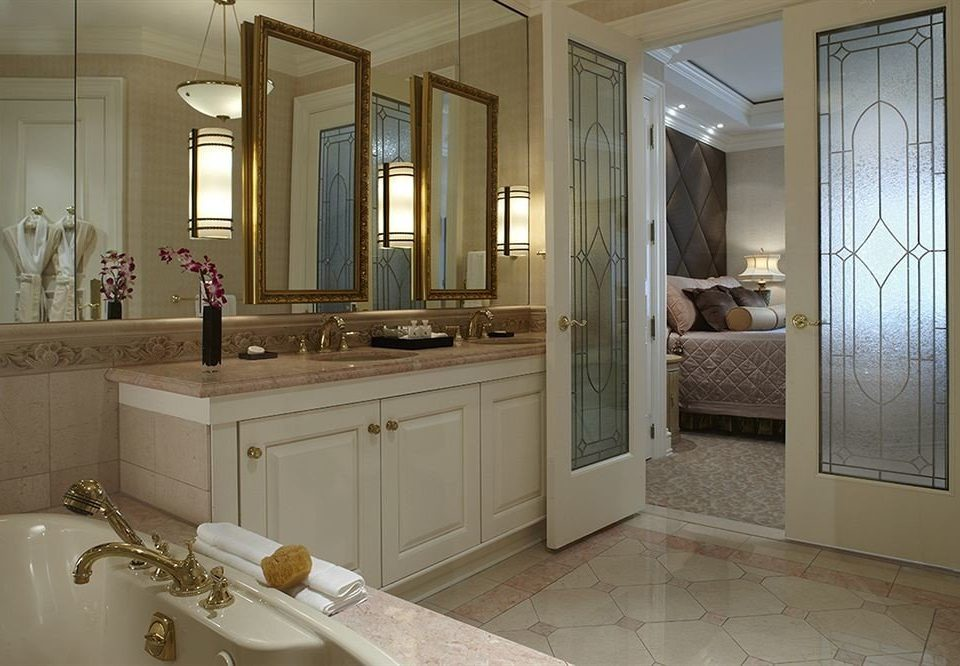 bathroom sink property mirror cabinetry home Kitchen cuisine classique flooring countertop cottage tile tub Bath tiled bathtub