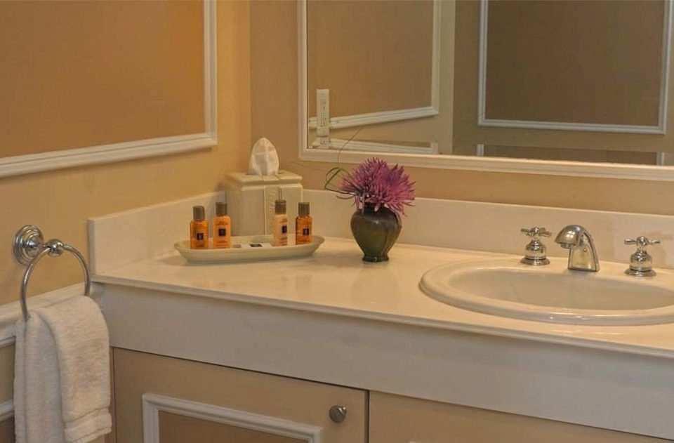 bathroom sink mirror countertop property Kitchen cabinetry hardwood home cottage material flooring Bath