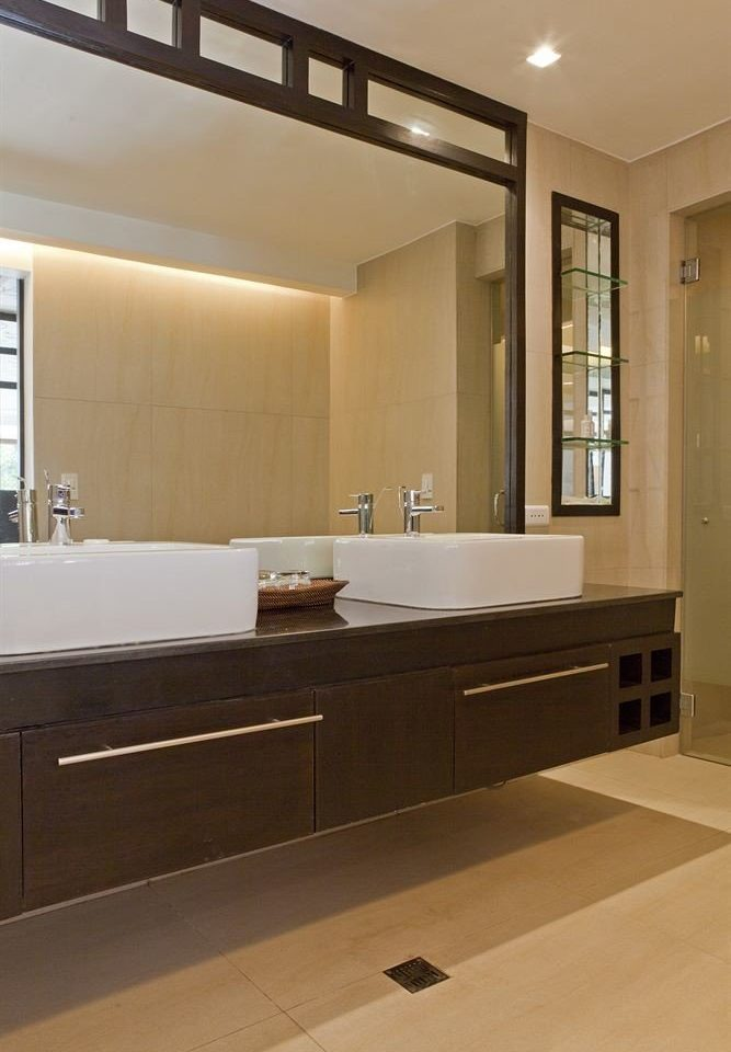 bathroom property mirror cabinetry sink hardwood countertop home flooring counter tile Kitchen wood flooring plumbing fixture tub Bath