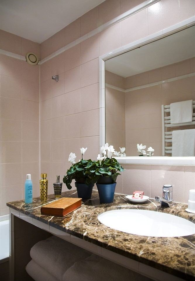 bathroom sink counter mirror property countertop Kitchen home vanity cabinetry living room flooring Bath