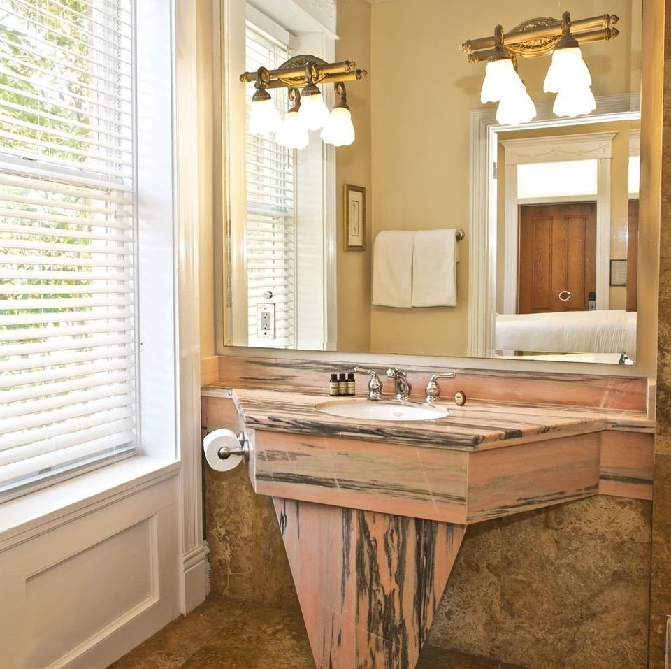 property bathroom cabinetry home hardwood countertop cottage Kitchen flooring farmhouse tub Bath
