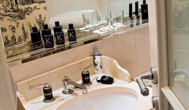 bathroom sink mirror toilet countertop tap Kitchen counter flooring Bath