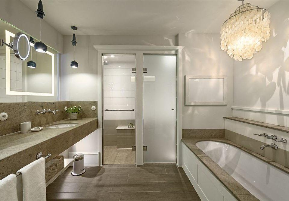 bathroom property sink home lighting toilet Kitchen flooring tub Bath