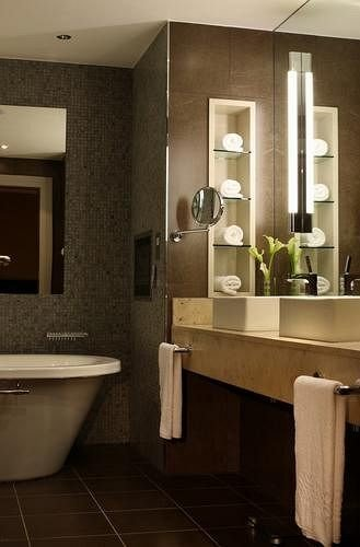 bathroom mirror sink cabinetry hardwood flooring home lighting tile countertop plumbing fixture towel Kitchen toilet Modern Bath