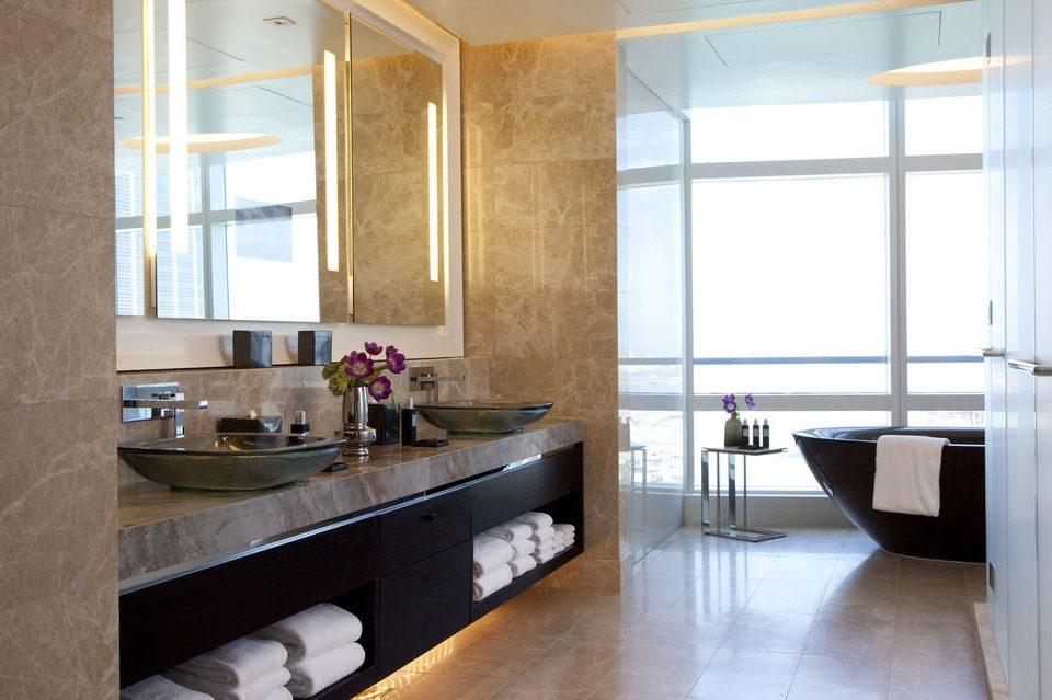 property Kitchen cabinetry home countertop condominium loft flooring Modern tub tile tiled Bath
