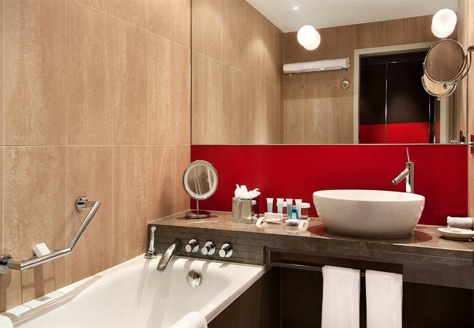 bathroom sink property mirror home Kitchen toilet countertop Suite vessel cabinetry Modern tub Bath bathtub
